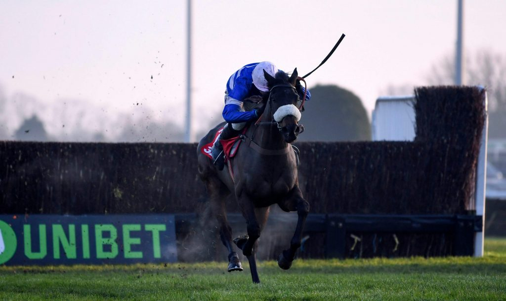 Kempton Park Racecourse, Sunbury-on-Thames, UK. 27th Dec, 2018. 32Red Winter Festival Horse Racing, day 2; Adrien Du Pont ridden by Harry Cobden on the way to winning the fifth race the 32RedCom Handicap Chase Credit: Action Plus Sports/Alamy Live News