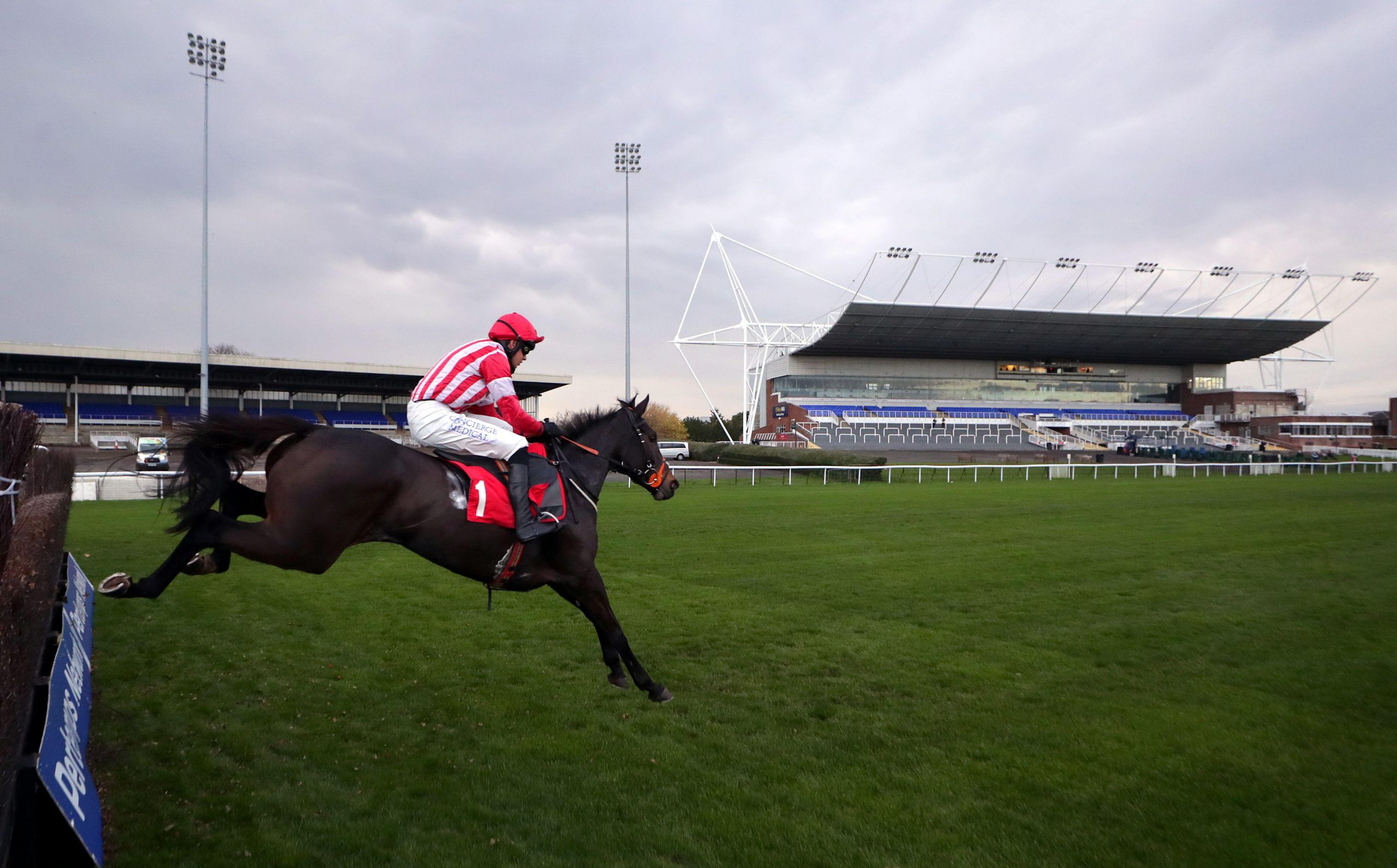 Oscar Rose ridden by jockey Liam Harrison clears a fence on the way to winning the Weatherbys TBA Mares' Handicap Chase (Challenger Mares' Chase Series Qualifier) at Kempton Park Racecourse.